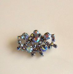 Hey, I found this really awesome Etsy listing at https://www.etsy.com/listing/80332433/vintage-brooch-aurora-borealis