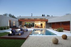 modern pool by Dumican Mosey Architects.  Like the contrast of the dark deck wood against the gravel and green grass.