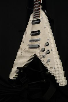 """My latest Moc is a 1967 Gibson Flying V guitar. As seen in the very popular Anime series FLCL or known as """"Furi Kuri"""" Guitar is LEGO parts with real guitar strings! Lego Guitar, Music Guitar, Cool Guitar, Unique Guitars, Custom Guitars, Vintage Guitars, Gibson Guitars, Fender Guitars, Gibson Flying V"""