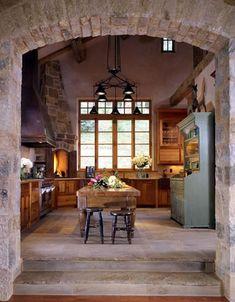Brick archway, pizza oven, stone floor, butcher block island...