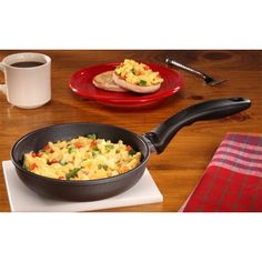 """The smallest Swiss Diamond Fry Pan at 18 cm (7""""), this skillet is just the right size for two eggs, a single chicken breast, and other small meals. The ergonomically designed handle is easy to hold, and the nonstick coating releases even burned-on food with no scrubbing. Simply wash under hot, soapy water. Heat-tempered glass lid available. $29.95"""