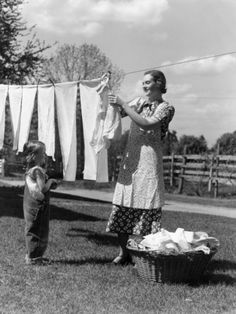 Mother and Daughter Doing Laundry, Hanging Wash on Clothesline in Backyard Photographic Print by H. Armstrong Roberts at Art.com