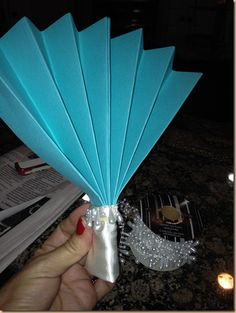 DIY Wedding Fan For An Outdoor Wedding.  Directions included using 2 sheets of cardstock, ribbon, glue and hot glue, and pearl trim.