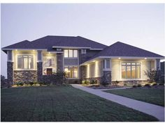 A modern take on Prairie style is celebrated on the facade of this lovely design. A see-through fireplace connects the great room and the breakfast area. Nearby, stairs lead up to a landing with double doors opening to the master suite. This suite features barrel-vaulted ceilings and an oval whirlpool tub.