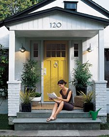inspiration for house colors: gray (brick), black (garage door and shutters), and yellow (front door)