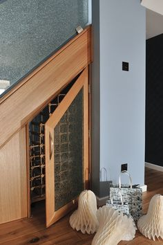Convenient and stylish under the stair wine storage.