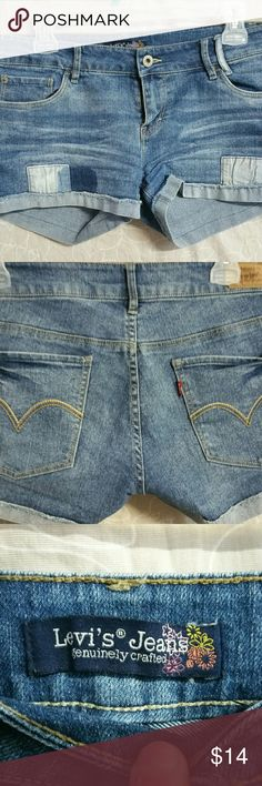 "Juniors 11 Levi jean shorts Adorable Levis jean shorts with patches 1""inseam Great condition except on back where there is a darker color in fabric where a patch must have been Shorts"