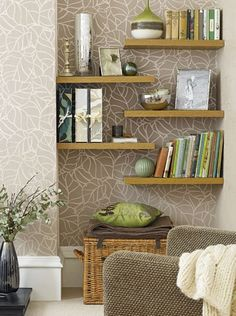 In a living room where space is limited and you need a place to store more, an alcove is ideal for hanging floating shelves to display books or decor accessories. Rather than have shelves that span the space, try staggering the arrangement for something different - or hang colourful patterned wallpaper at the back to make a feature.
