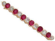 1.48 ct Ruby and 0.85 ct Diamond, 14 ct Rose Gold Bar Brooch - Antique Victorian SKU: A3829 Price GBP £1,595.00 http://www.acsilver.co.uk/shop/pc/1-48-ct-Ruby-and-0-85-ct-Diamond-14-ct-Rose-Gold-Bar-Brooch-Antique-Victorian-35p7772.htm#.VjswOL88rfc
