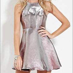 SALE New holographic dress This is a really cool dress because it's silver and pink depending on what way you look at it everyone will be looking at you when you wear this dress and be in awe of how unique it is size L Forever 21 Dresses