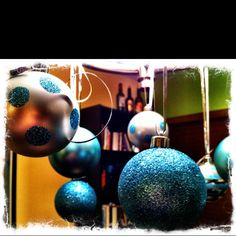 DIY decor. Hang Xmas decorations from your kitchen chandelier!