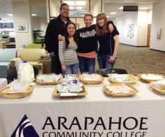 Student Recruitment and Outreach held a bake sale on Wednesday, Feb. 19, in the Second Floor Student Lounge.  Proceeds were donated to the ACC Student Emergency Fund.  Pictured (from left): Recruitment Specialist Edward Nance and Student Ambassadors Janay Archuleta, Amy Stuever and Nicole Moore.