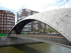 Puente Cascara - Madrid, Spain (2010);      designed by west8, working with MRIO to complete a master plan for the reclaimed riverbanks and new urban area above the tunnels of the M30 highway;  the ceilings have mosaic art by the Spanish artist Daniel Canogar