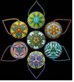 Carol Simmons Kaleidoscope Cane Pendants via The Polymer Arts