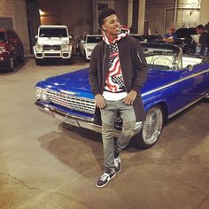 Nick-Young-wears-Fear-of-God-LA-jacket-Supreme-Hoodie-Balmain-Jeans-and-Saint-Laurent-low-top-sneakers-shoes