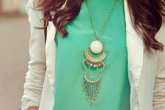 mint green blouse with white blazer.