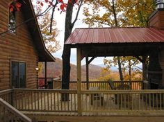 Covered deck with outdoor fireplace. Wow! North Georgia cabin rentals - Ellijay cabin rentals -Blue Sky Cabin Rentals
