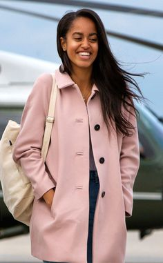 Pretty in Pink from Malia Obama's Best Fashion Styles  The First Daughter wears a blush coat as she waits to boardAir Force One inChicago.