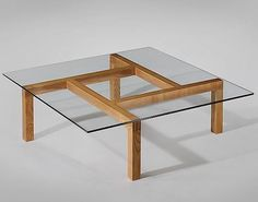 Unique Ash and Glass Coffee Table for His Apartment designed by Pierre Guariche.