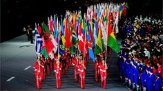 Flagbearers weave a trail of colour through the Stadium #Olympics