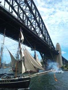 The James Craig crosses the Sydney Harbour Bridge finishing line ahead of Southern Swan and HMB Endeavour