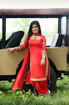 Kaur b Red suit