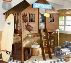You can almost hear the surf! This beach themed bedroom has a cottage-style upper bunk with lounging below. Surfboard lends an adventurous feel.