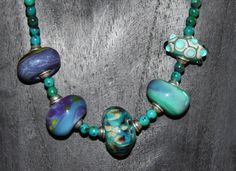 My first lampwork beads from my 1st Workshop with Paya Van Dyck - strung in combination with silver and semi-precious stone beads