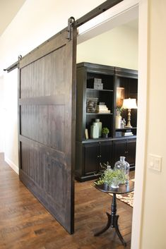 Custom Made Barn Door by Riverwoods Mill | CustomMade.com  I'd like to do this with a security screen on my side garage door. The dogs could be sequestered in the garage but still get air, and the small space wouldn't be compromised