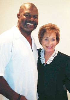 Judge Judy's Bailiff | ... poses with Judge Judy in between taping episodes of Judge Alex