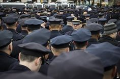 A lone officer faces forward as colleagues turn their backs while Mayor Bill de Blasio speaks during the funeral of New York Police Department Officer Wenjian Liu, 4 January - Full respect Officer! You clearly know a real policeman's duties.