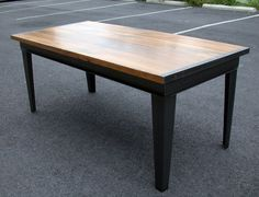 Dining table with reclaimed wood and metal reclaimed from an industrial factory