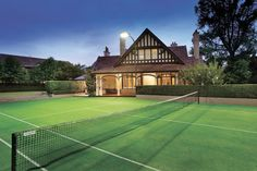 A mod-grass tennis court adds to this magnificent landmark residence