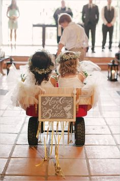 flower girls in a wagon pulled by ring bearer