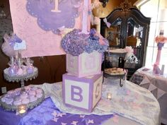 a lavender purple and pink first birthday tea party
