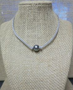 """Grey Pearl Suede Leather Choker Necklace with Extension Chain You CHOOSE COLOR CORD  Suede Cord - 3mm width (Your Choice) Choose from many of our colored suede cord. Lots to choose from!  Length -14"""" with 4"""" extension chain.  Grey pearl - 10-12mm diameter.    This """"suede"""" is actually made from specially treated microfibers -- it will NOT crack, weather, or smell. Just like leather, only better! Lasts longer, and it's cruelty free! This fantastic cord is used with standard type findings…"""