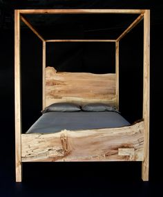 The clean, stark lines of Trace's queen spalted maple canopy bed frame allows the dramatic proportion and meticulously crafted sweep of the head and foot boards to take center stage. Style and simplicity give this piece the warmth and appeal of a family heirloom.