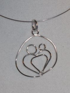 Wire Wrapped Mother and Child Pendant. $6.00, via Etsy.