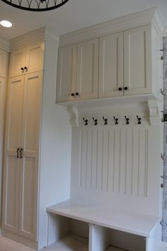 tall closet at end: brooms, mops, vacuum? Part mud room part nursing scrub derobe room :)