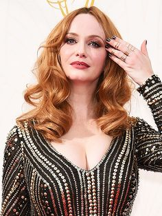 The Very Best of Beauty from the 2015 Emmy Awards | MOST ON-POINT MANICURE: CHRISTINA HENDRICKS | What do you pair with a gorgeous intricately beaded Naeem Khan design? An equally intricate manicure, of course! Just ask Christina, who stepped out with the most memorable mani of the night: a black-and-gold striped nail job.