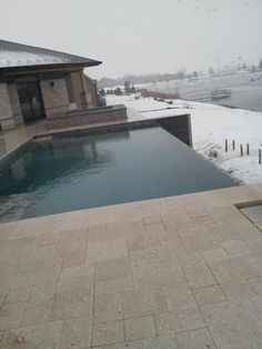 This infinity edge pool in Manhattan, IL was built this winter under a tent by All Seasons Pools and Spas from Orland Park, IL