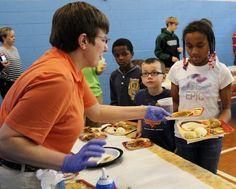 Everyone loves dessert! Carla helps served pumpkin pie to a few kids.