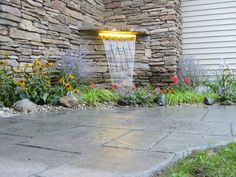 Pondless waterfall built into the side of the house