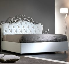 Forms Bed The royal flair of this bed makes it stand out. This is a very exclusive centrepiece for your bedroom and a great asset to your house in general. The wrought iron frame gives durability, resistance and reliability to the bed in general. Furniture Dolly, Bed Furniture, Furniture Makeover, Furniture Design, Furniture Movers, Furniture Companies, White Upholstered Headboard, Living Room Decor, Bedroom Decor
