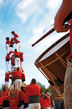 """One of Catalonia's most famous traditions is that of the """"castells"""" (castles), which are human towers that are lifted by building different levels of people."""