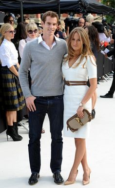 Kim Sears - white dress and brown belt & bag with nude shoes.  (love love)