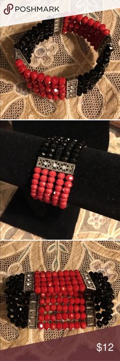 Black and red rhinestone stretch bracelet Worn once for a special occasion. Beautiful black and red beaded stretch bracelet. Silver bars with rhinestone inserts at 4 intervals on the band. Beads are faceted and comfortable to wear. Bundle for more discounts 😊👍🏻🎉 Jewelry Bracelets