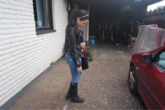 Young lady in leather jacket, jeans and johnny bulls boots