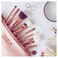 Majorly lusting after the @zoevacosmetics Rose Gold brushes but I can't decide between these and the @spectrumcollections Marbellous ones! : @frockmeimfamous