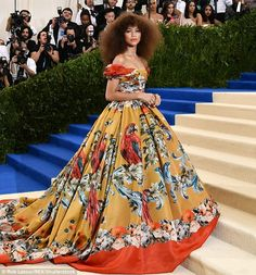 Taking flight: Zendaya looked stunning in a floor-length yellow and orange gown printed with red and blue parrots at this year's Met Gala